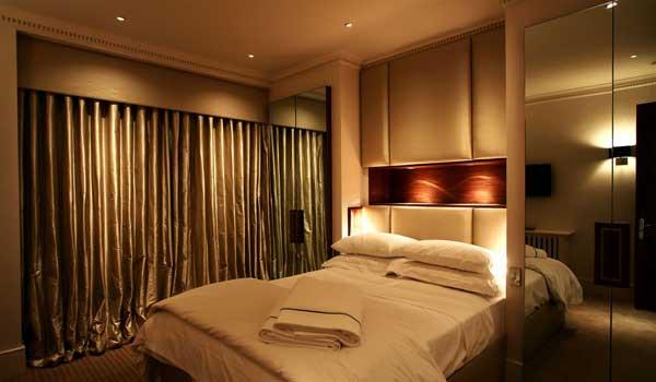 Как устроить освещение в спальне